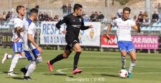 Gerard Oliva peleando ante varios oponentes del Deportivo Aragón. Foto: GuiemSports.